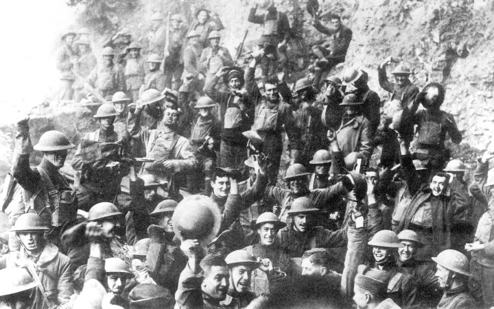 Men of U.S. 64th Regiment, 7th Infantry Division, celebrating the news of the Armistice.