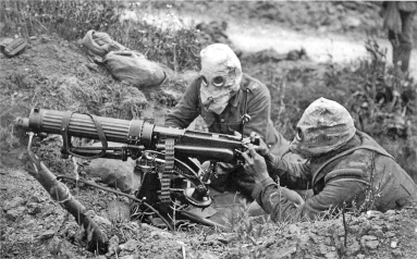 German machine gun crew on the Somme, equipped with early gas masks.